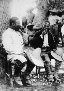 Mexican revolutionary leader Pancho Villa (1878 - 1923) (L) sits against a tree with a fellow soldier, their straw hats over their knees, following the Mexican Revolution of 1911. (Photo by Hulton Archive/Getty Images)